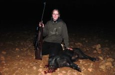 Young female hunter with keiler