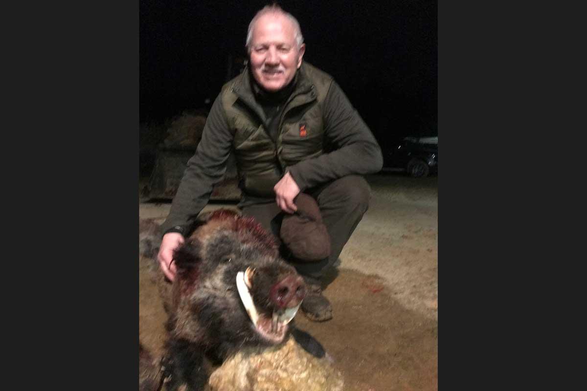 Hunter with huge gold medal trophy - wild boar, keiler